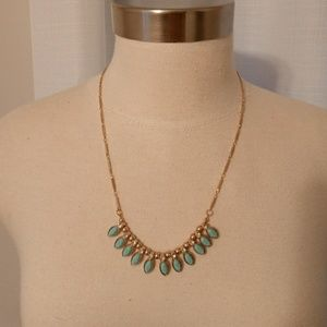 Pretty turquoise stone and rhinestone gold colored